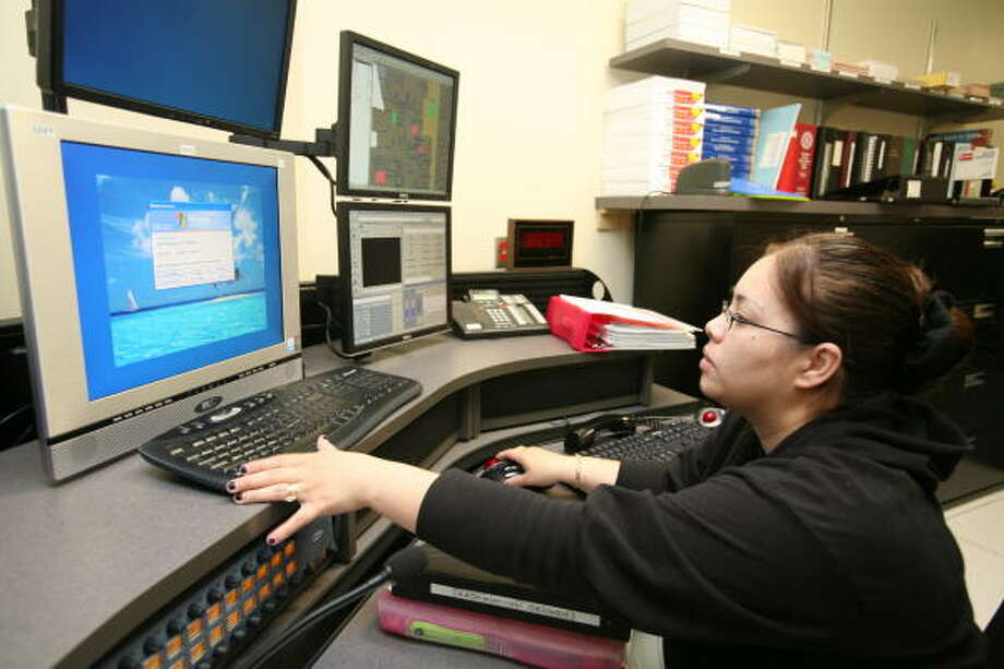 Dispatcher Zully Moreno works in the communications center at the new Katy police station. Photo: Suzanne Rehak, For The Chronicle