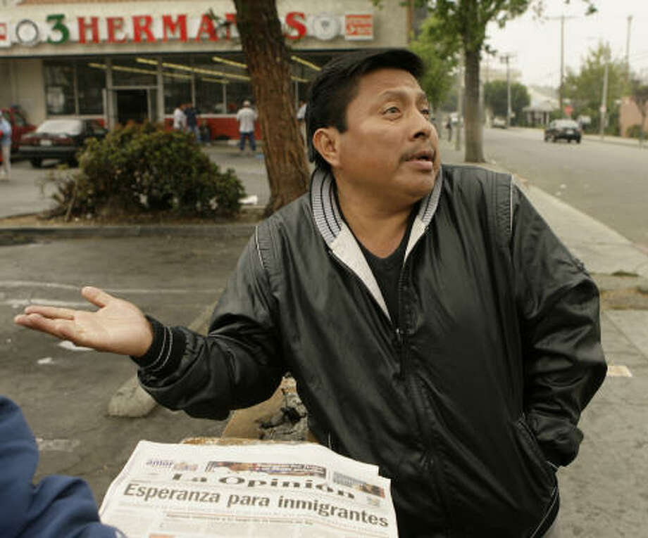 Day laborer Juan Carlos Vazquez expresses his reaction to the immigration reform proposal Friday outside a Home Depot in Los Angeles. Undocumented immigrants and advocacy groups sharply criticized the Senate's reform proposal, saying the provisions are overly harsh and will drive many people deeper into the shadows. Photo: Damian Dovarganes, AP