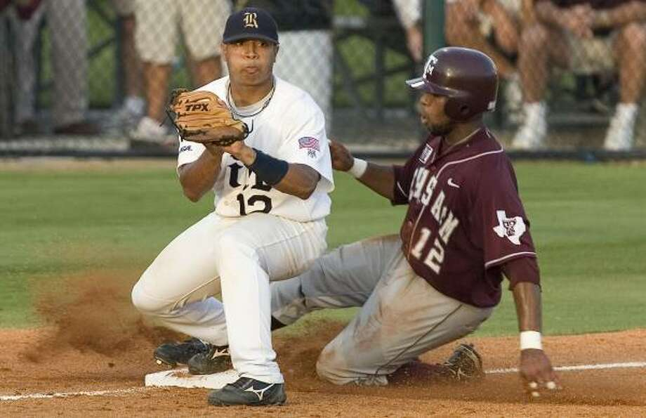 Rice third baseman Diego Seastrunk gets the force out on A&M's Kyle Colligan during the sixth inning. Photo: Dave Einsel, AP