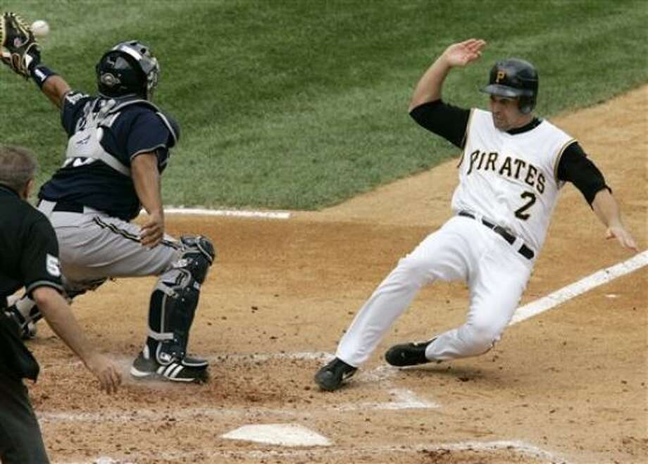 Jack Wilson scores for the Pirates, who dropped the Brewers to 19-38 in Pittsburgh since 2001. Photo: Gene J. Puskar, AP