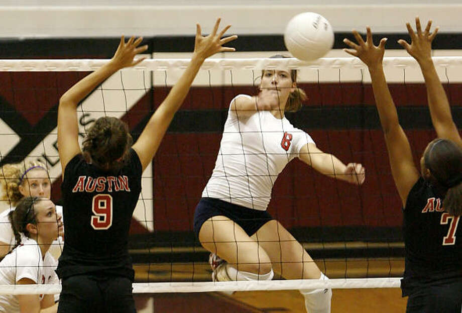 Clear Lake's Natasha Law delivers a kill against Fort Bend Austin during the Pearland Invitational tournament last week. The Falcon girls visit Pearland in their District 24-5A opener Friday. Photo: Diana L. Porter, For The Chronicle