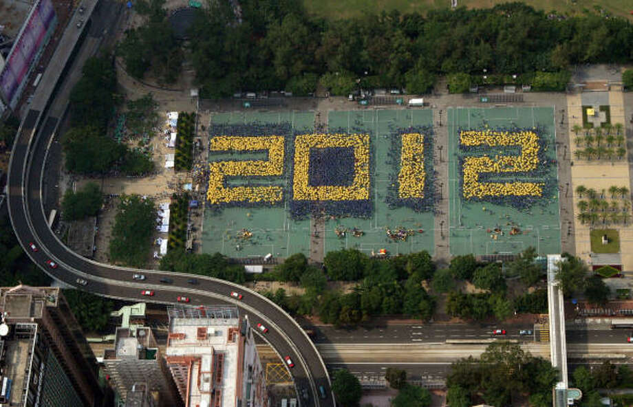 Demonstrators spell out 2012, the year they want full democracy by, at a Hong Kong park today. Photo: AFP/Getty Images