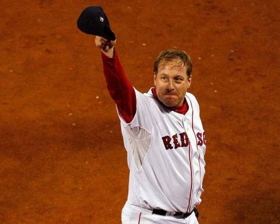 Boston's answer to being down 3-2 in the ALCS was to trot out postseason workhorse Curt Schilling, whose masterful night at Fenway squared the series with Cleveland at three games apiece. Photo: JIM ROGASH, GETTY IMAGES