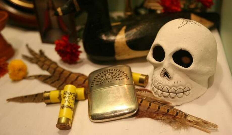 Sarah Cortez placed shotgun ammunition and duck feathers on her Day of the Dead altar. Photo: MAYRA BELTRÁN, CHRONICLE
