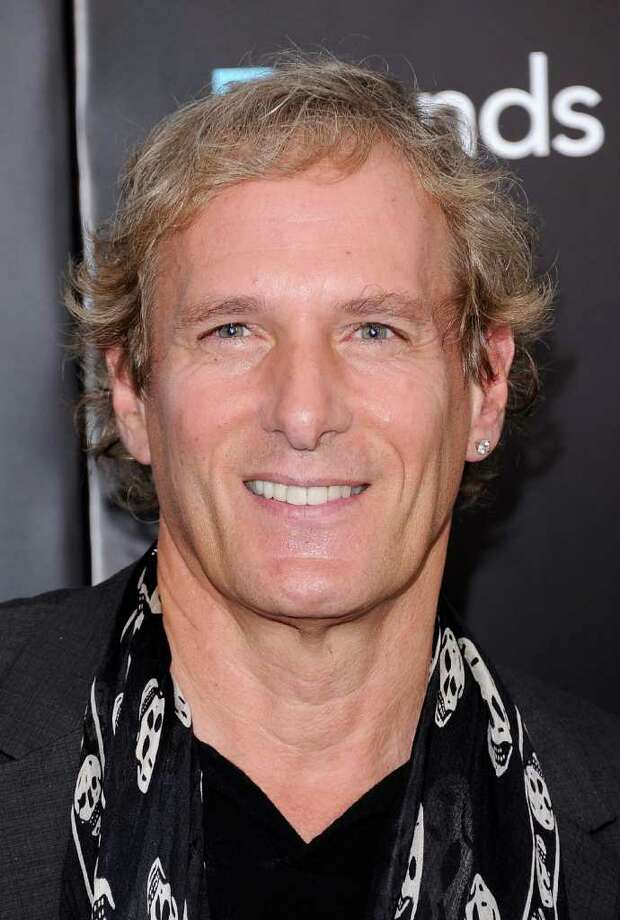 "Westport resident Michael Bolton, pictured attending the ""Friends with Benefits"" premiere in New York City July 18, was seen having dinner at Gabriele's Italian Steak House in Greenwich last weekend. (Photo by Jemal Countess/Getty Images) Photo: Jemal Countess, Getty Images / 2011 Getty Images"