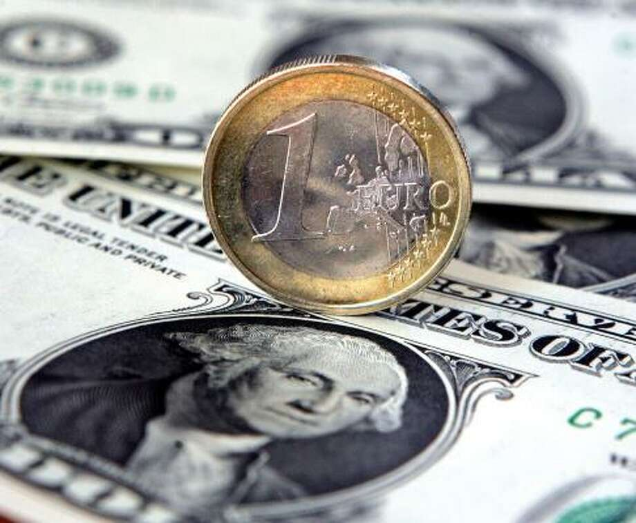 The strength of the euro is propelling Europe's currency into a juggernaut. Meanwhile, the dollar is suffering. Photo: MARTIN MEISSNER, ASSOCIATED PRESS FILE