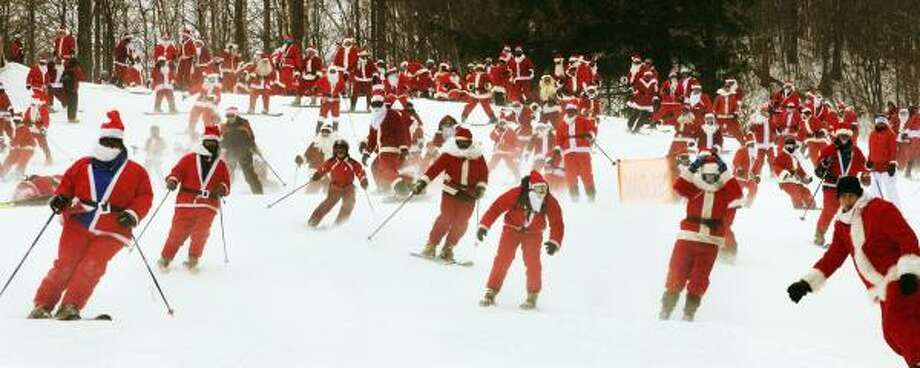 More than 220 Santas hit the slope at Sunday River ski resort in Newry, Maine. The event raised money for children's toys. Photo: NICK LAMBERT, ASSOCIATED PRESS