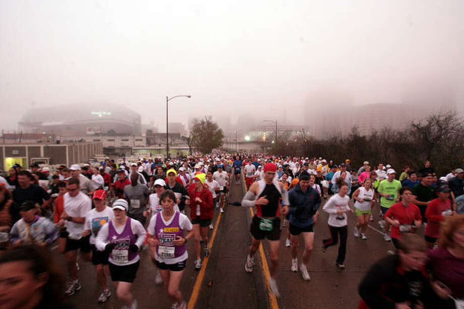 Runners keep their eyes on the prize at the Chevron Houston Marathon in January. Photo: MAYRA BELTRÁN, Chronicle