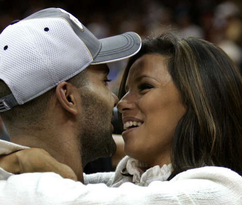 Eva Longoria, shown celebrating with then-fiance Tony Parker after he and his San Antonio Spurs won the NBA title last year, says she was blamed for problems he had on the court. Photo: TIMOTHY A. CLARY, AFP/Getty Images
