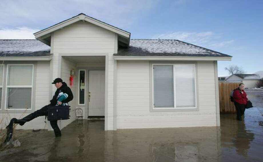 David and Cassie Russell returned to their home in Fernley, Nev., on Sunday to find it damaged by about 2 feet of floodwater. Photo: BRAD HORN, ASSOCIATED PRESS