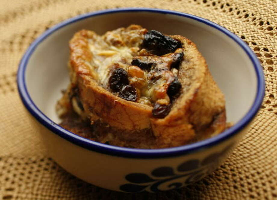 PASS THE PUDDING, PLEASE:South Texas cookbook author Melissa Guerra uses prunes, green onions and pecans to make her capirotada. Photo: Kevin Fujii, Chronicle