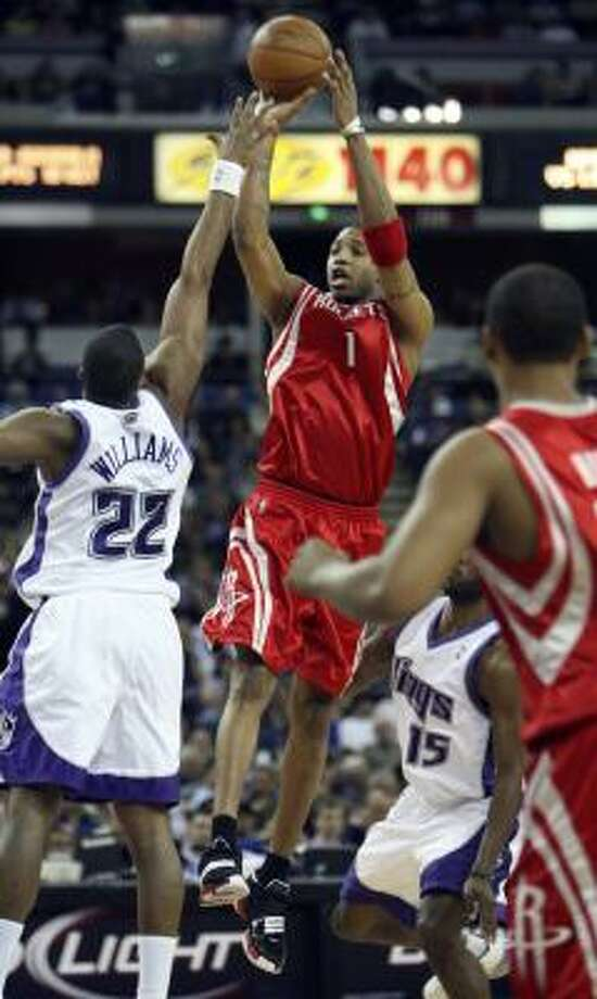 Rockets guard Tracy McGrady shoots over Kings defender Shelden Williams on Tuesday. Photo: Steve Yeater, AP
