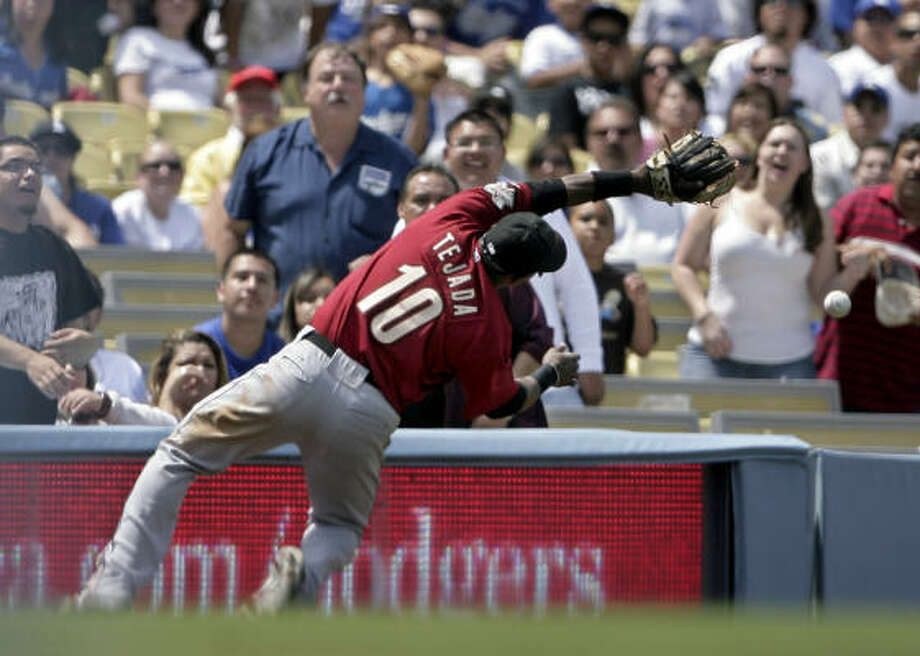 Miguel Tejada made a diving attempt to catch Delwyn Young's pop up in the fourth inning, but came up short. Photo: Ric Francis, AP