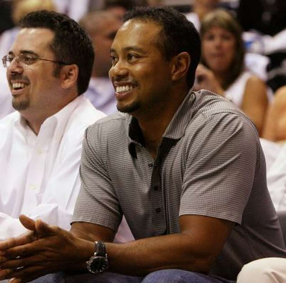 Recovering from knee surgery, Tiger Woods took in an Orlando Magic playoff game last Saturday; fellow golfers at The Players Championship weren't exactly depressed to see him sit that one out. Photo: DOUG BENC, GETTY IMAGES