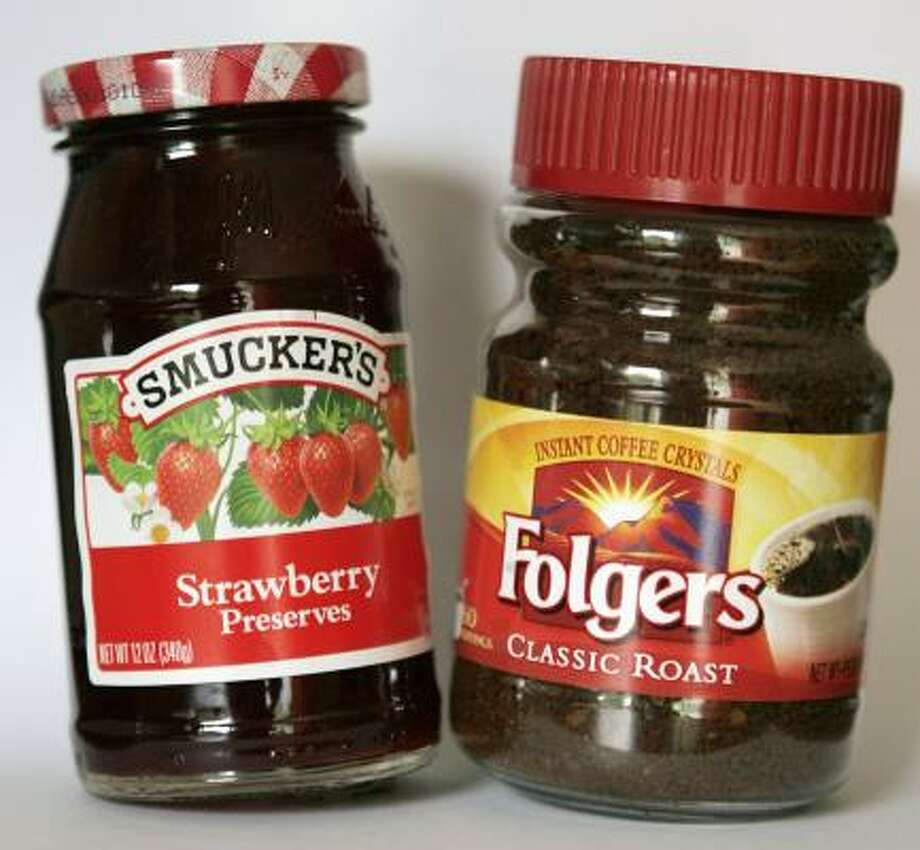 The purchase of the Folgers coffee brand from Procter & Gamble in a $3 billion deal will nearly double the size of jams and jellies maker J.M. Smucker. Photo: STEVEN SENNE, ASSOCIATED PRESS