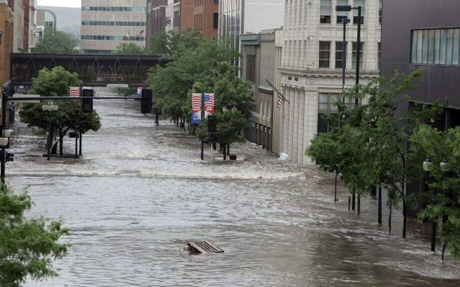 Officials said about 100 blocks of the city were underwater Thursday after the Cedar River breached its banks. Photo: JEFF ROBERSON, ASSOCIATED PRESS