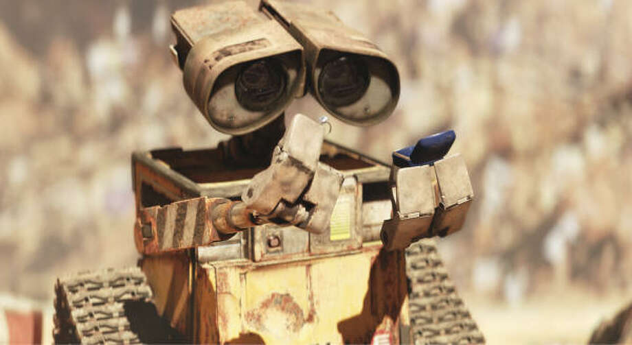 WALL-E is a robot who compacts trash and places it in piles. Photo: DISNEY / PIXAR