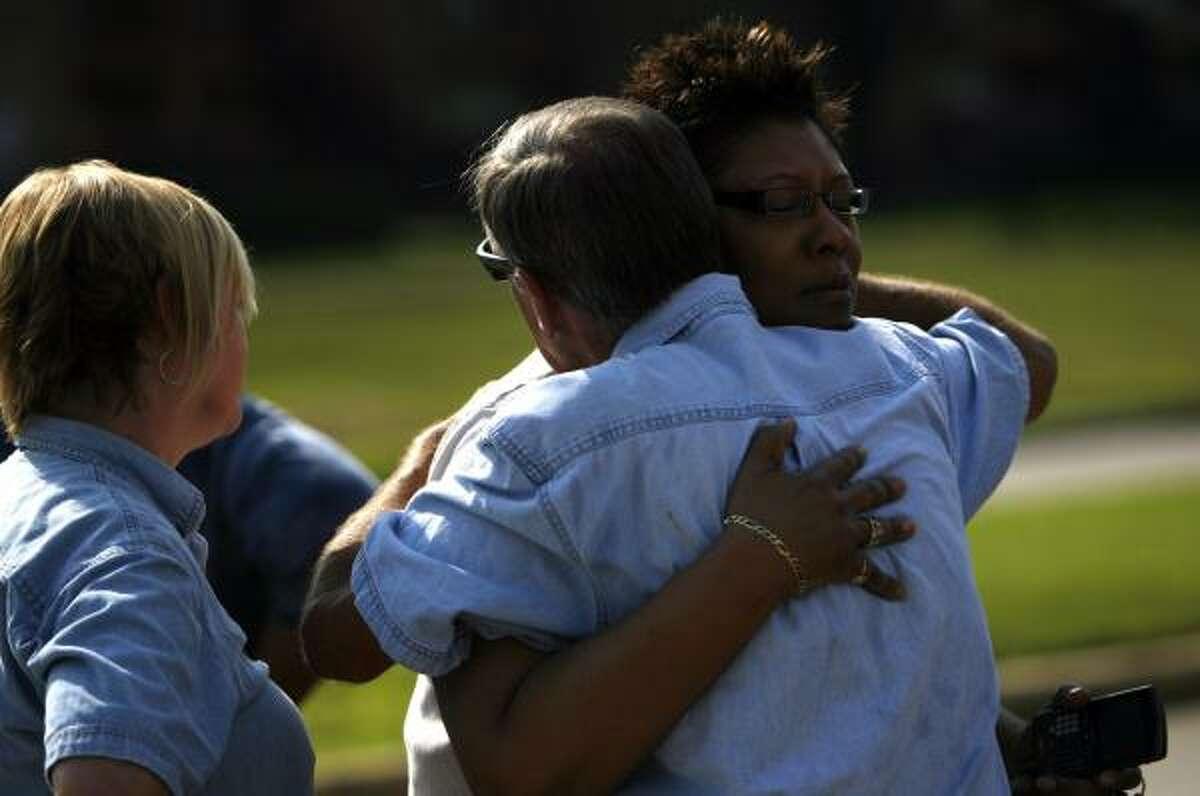 Tim Miller, Texas EquuSearch director, hugs the missing children's grandmother, Alanda Sylvester, Wednesday in Pasadena.