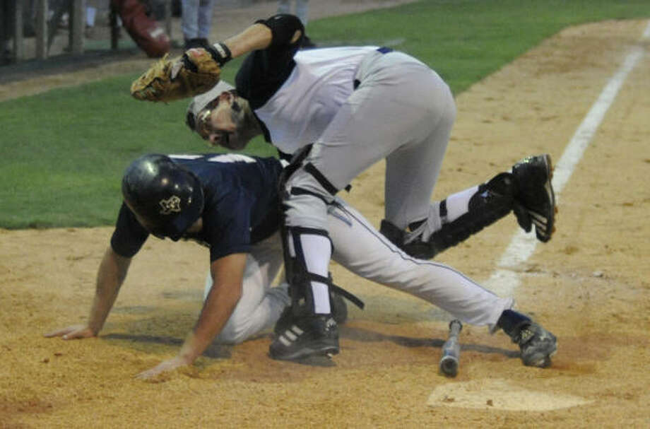 There's no lack of action in the four-team league, even though the average age of most team members is 55. Photo: Steve Ueckert, Chronicle