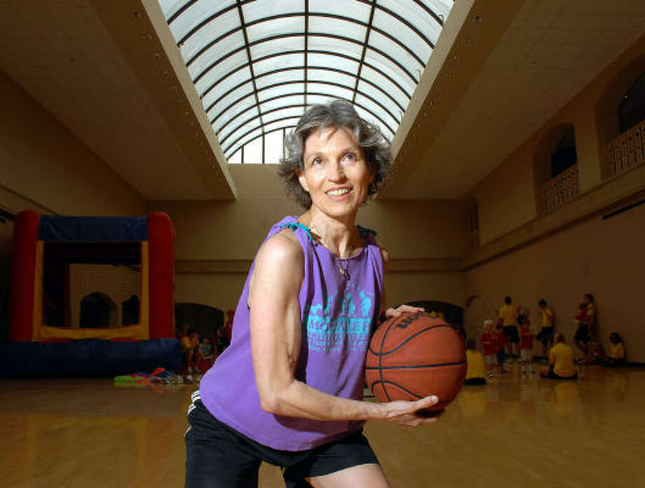 Lorelei de la Reza, 64, practices her basketball skills at The Houstonian. Her team advanced to the Senior Olympics in 2007, although they did not win a medal. Photo: Dave Rossman, For The Chronicle