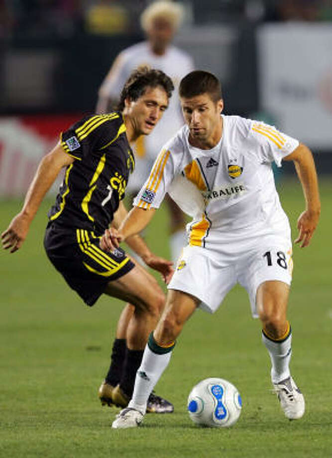 Guillermo Barros Schelotto, left, of the Columbus Crew is Bernardo Fallas' pick for MLS MVP. Photo: Lisa Blumenfeld, Getty Images