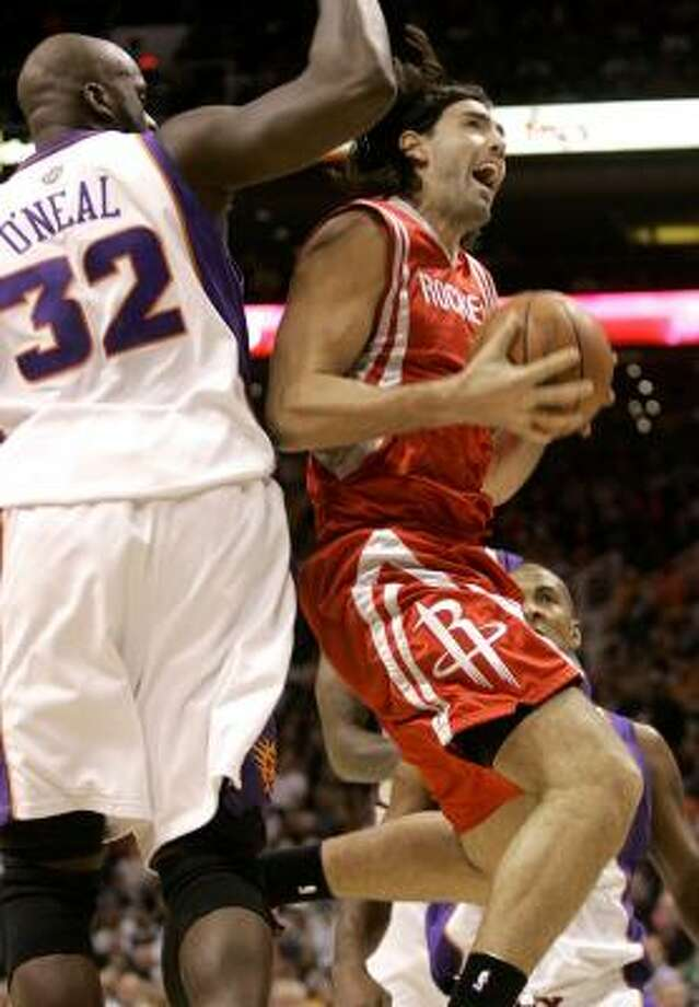 The Rockets have used a combination of forwards Carl Landry, Luis Scola, right, and Chuck Hayes to back up Yao Ming at center. Photo: Matt York, AP