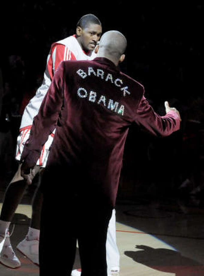 The Rockets' Steve Francis wears a jacket supporting President-elect Barack Obama as teammate Ron Artest is introduced before Tuesday's game against Boston. Photo: Pat Sullivan, AP