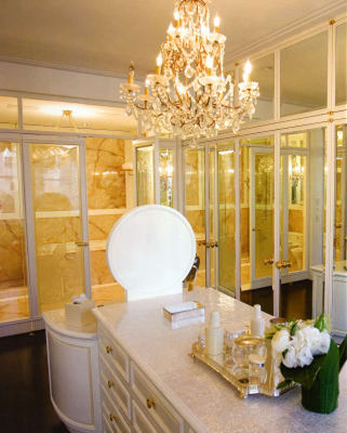 A crystal chandelier lends showstopping glamour to this New York apartment bathroom, as featured in The Luxury Bathroom (Clarkson Potter, $60).