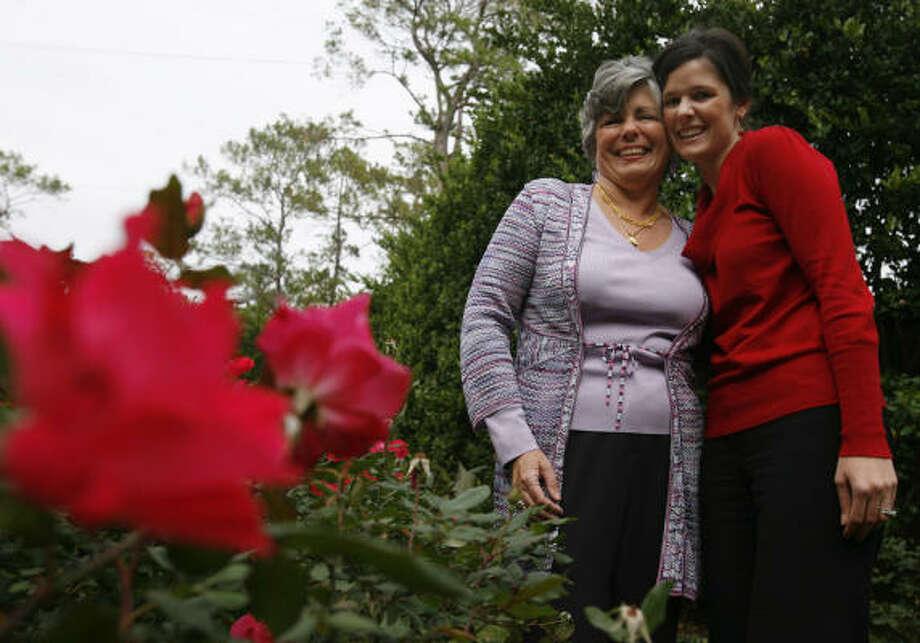 Irene Hunsicker and her daughter, Kelly Hunsicker pose in Irene's rose garden in Houston. Photo: Sharon Steinmann, Chronicle