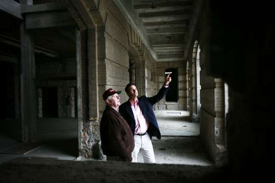 Jim Gleason, left, and Rich Elwood of the Harris County Public Infrastructure Department, point out where stairs that led to the main entrance on the second floor of the old Civil Courthouse will be rebuilt. Photo: MICHAEL PAULSEN PHOTOS, CHRONICLE