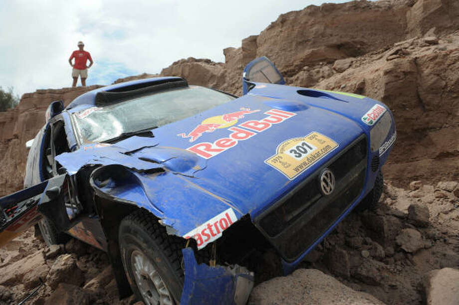 The Volkswagen of driver Carlos Sainz rests in a ravine during a stage that started in Fiambala, Argentina. Photo: Gabriel Bouys, AP