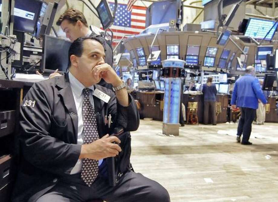 Trader Philip Tursellino watches index numbers at the New York Stock Exchange on Friday after the bailout bill passed in the House of Representatives. Photo: RICHARD DREW, ASSOCIATED PRESS