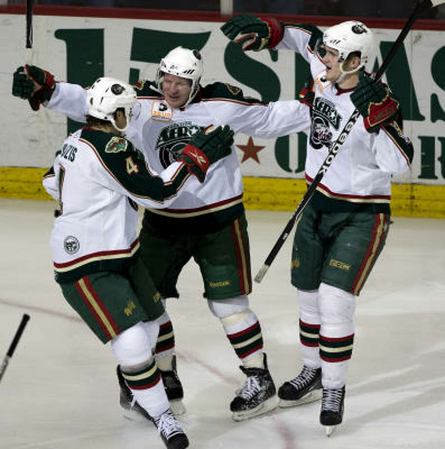 Tony Hrkac, center, scored two goals in Game 5, including the game winner in double overtime after the Aeros blew a 3-0 third-period lead. Photo: Bob Levey, For The Chronicle