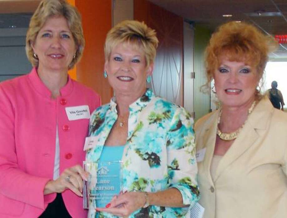 KUDOS: Vita Goodell (left), executive director of the Women's Center of Fort Bend, and Joy Dowell (right), chair of the Center's board of directors, congratulate Prudential Gary Greene, Realtors' Lane Pearson, who was named Council of Resources Member of the Year.