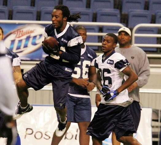 Cornerback Mike Jenkins (left) intercepts a pass intended for receiver Raymond Radway (86) during the morning session of the Dallas Cowboys training camp at the Alamodome on Saturday, July 30, 2011. Kin Man Hui/kmhui@express-news.net Photo: KIN MAN HUI, : / SAN ANTONIO EXPRESS-NEWS
