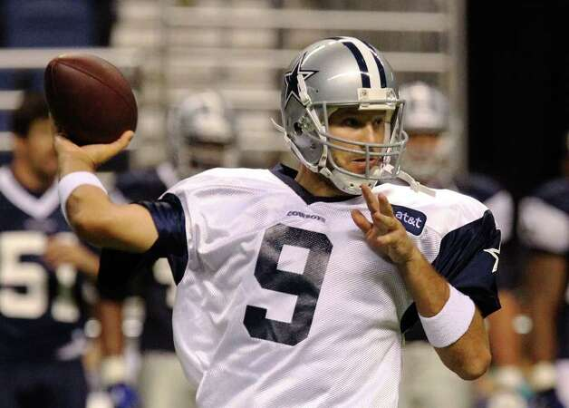 Quarterback Tony Romo drops back for a pass during the afternoon session of the Dallas Cowboys training camp at the Alamodome on Saturday, July 30, 2011. Kin Man Hui/kmhui@express-news.net Photo: KIN MAN HUI, : / SAN ANTONIO EXPRESS-NEWS