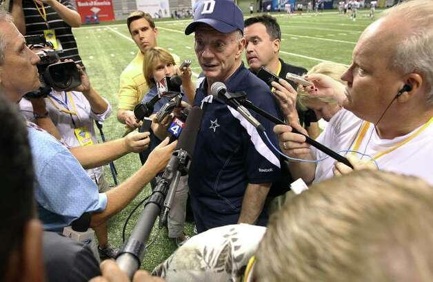 Cowboys owner Jerry Jones (center) talks to media after the afternoon session of the Dallas Cowboys training camp at the Alamodome on Saturday, July 30, 2011. Kin Man Hui/kmhui@express-news.net Photo: KIN MAN HUI, : / SAN ANTONIO EXPRESS-NEWS