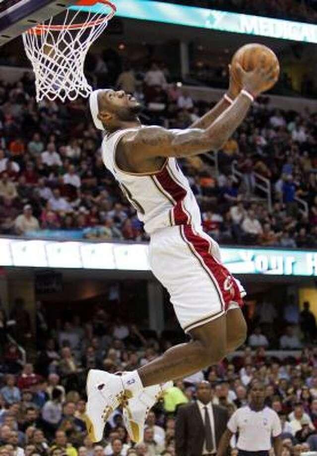 LeBron James lines up a reverse dunk. Photo: MARK DUNCAN, ASSOCIATED PRESS