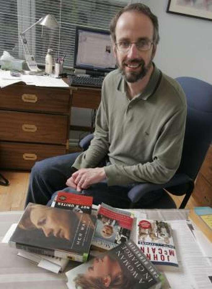 Jonathan Schilling, of Marlboro, N.J., keeps reference books handy as he patrols Wikipedia entries. Photo: JENNIFER HULSHIZER, NEWHOUSE