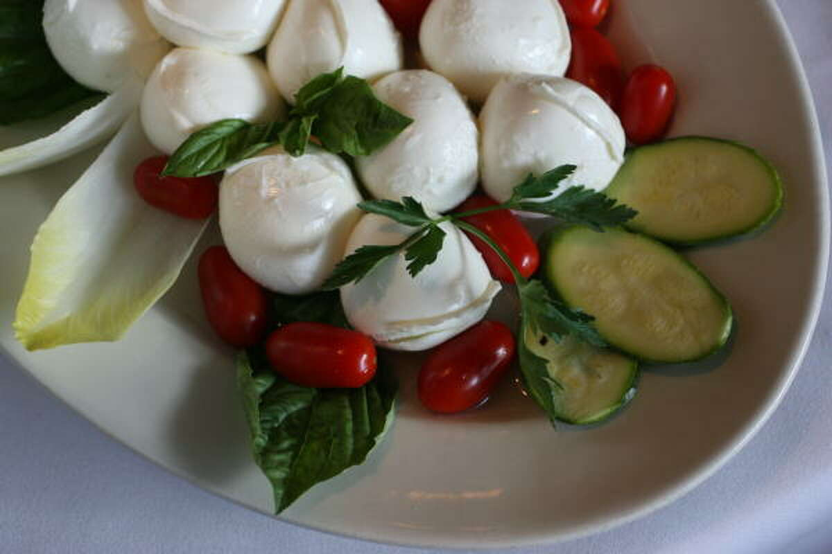 The mozzarella salad plate with eggplant and zucchini instead of tomatoes is served at Arcodoro Ristorante Italiano.