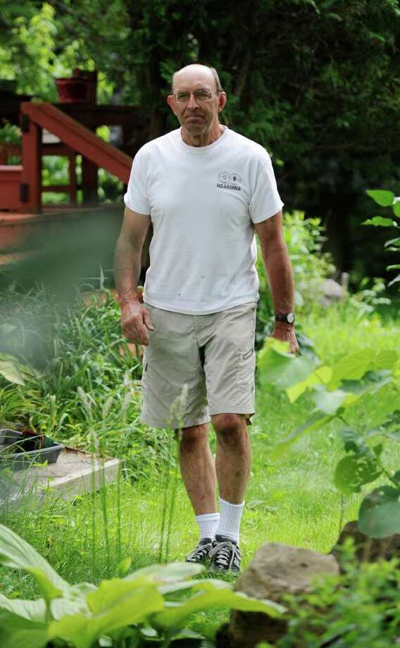 Storyteller Joy Bruchac who won an award from the National Storytelling Network walks through the foliage in the backyard of his home in Greenfield Center, N.Y. July 7, 2011.   (Skip Dickstein / Times Union) Photo: SKIP DICKSTEIN / 00013818A