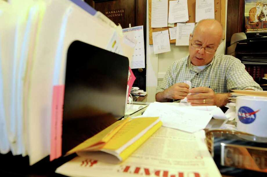 """Deputy city clerk Charles """"Chuck"""" Thorne works at his desk on Friday, July 29, 2011, at City Hall in Schenectady, N.Y. Thorne established an opt-out system for Schenectady residents who don't want to have salespeople coming to their doors. (Cindy Schultz / Times Union) Photo: Cindy Schultz"""
