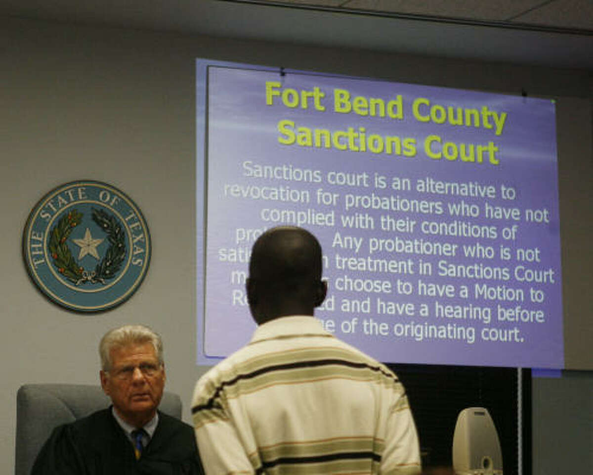 Defendants appear before Judge A. Reagan Clark in the Special Sanctions Court that closely monitor people on probation at the William B. Travis Building in Richmond, Texas.