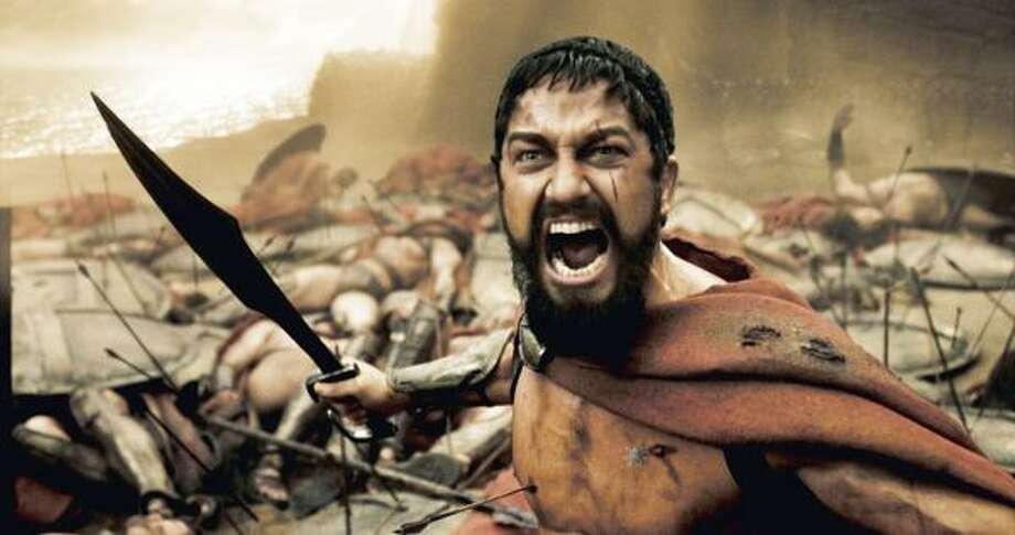 A wounded Leonidas, played by Gerard Butler, roars his defiance at the Persian invaders. Photo: Warner Bros.