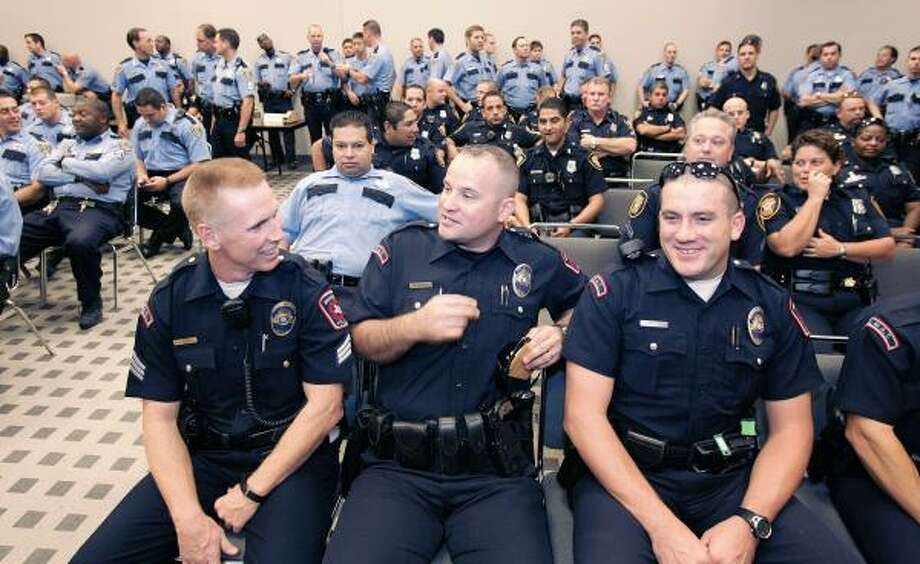 Mansfield police officers attend roll call before departing for their evening tactical assignments in southwest Houston. Photo: CRAIG H. HARTLEY, FOR THE CHRONICLE