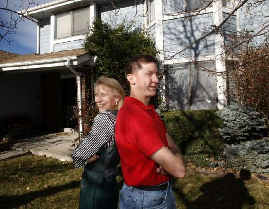 Nancy Partridge and David Snyder were divorced in January, but the bad economy has forced them to live together. Photo: DAVID ZALUBOWSKI, ASSOCIATED PRESS