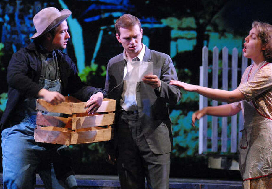 Tommy (Jeff Goble), center, Pa (Mitchell Galloway-Edgar) and Ma (Laura Riggs) Joad talk about a handbill promising good jobs in California. Photo: Dave Rossman, For The Chronicle