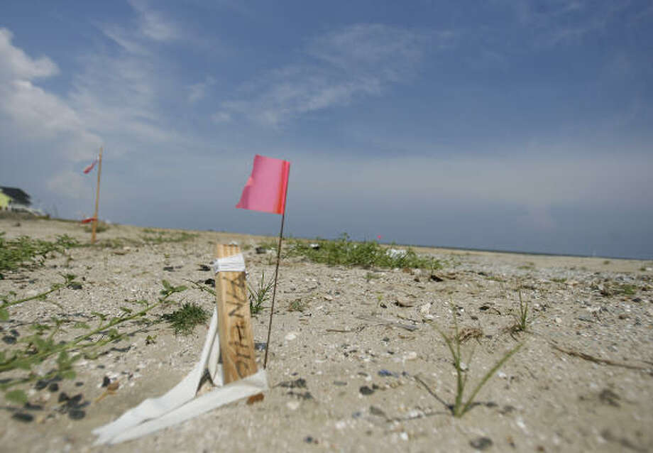 Like the marker that shows the former location of state Rep. Wayne Christian's house at Crystal Beach, the amendment he helped pass has raised a red flag for political observers. Photo: Karen Warren, Chronicle