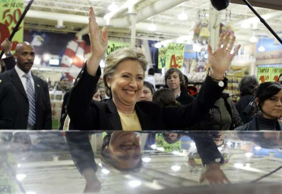 Sen. Hillary Clinton greets workers behind the meat counter at the El Rey grocery store during a campaign stop Sunday in Milwaukee. Photo: CAROLYN KASTER, ASSOCIATED PRESS