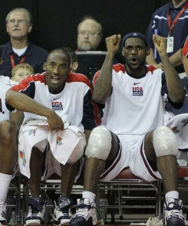 In this Sept. 2, 2007 file photo, United States' Kobe Bryant, left, and LeBron James react after their teammate Deron Williams scored against Argentina during their FIBA Americas Championship gold medal basketball game at the Thomas & Mack Center in Las Vegas.  The two NBA superstars were part of the U.S. men's basketball that was announced Monday June 23, 2008 for the Beijing Games. Photo: Jae C. Hong, AP